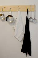 white fine linen dish towel, with a small ribbon to hang it.