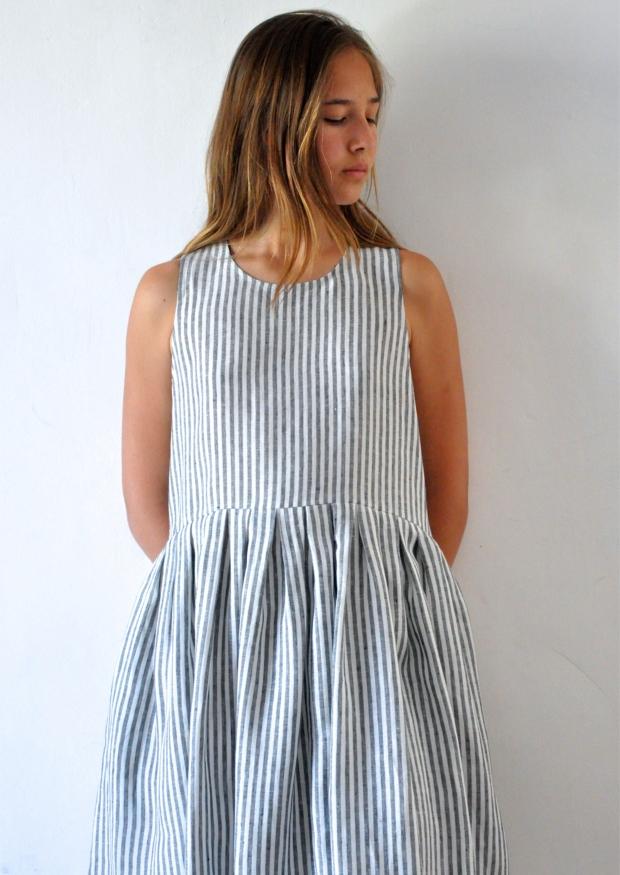 Uniform pleated dress, sleeveless, light stripes linen