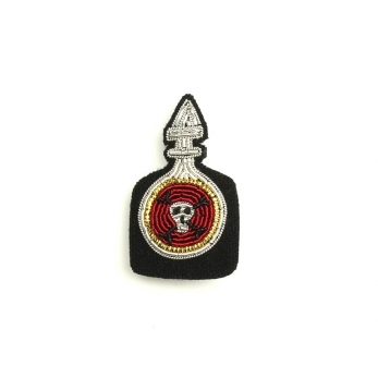 Broche Poison rouge