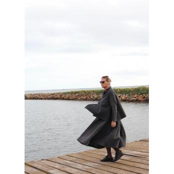 Flared sleeveless jacket, grey wool with raw edges