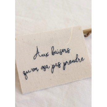 """Embroided words """"Aux baisers..."""""""